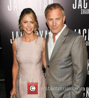 Kevin Costner Christine Baumgartner - Los Angeles Premiere of 'Jack Ryan: Shadow Recruit' at the TCL Chinese Theatre - Red Carpet...