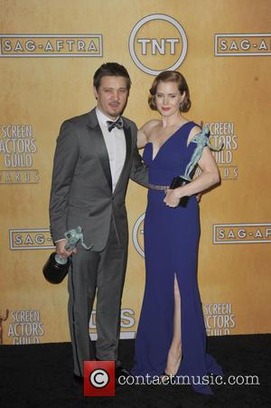 Amy Adams and Jeremy Renner - 20th Annual Screen Actors Guild Awards - Press Room - Los Angeles, California, United...
