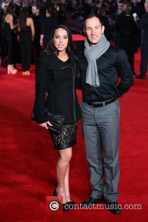 Beth Tweddle and Lukasz Rozycki - 'Jack Ryan: Shadow Recruit' UK premiere at Vue cinema - Red Carpet Arrivals -...