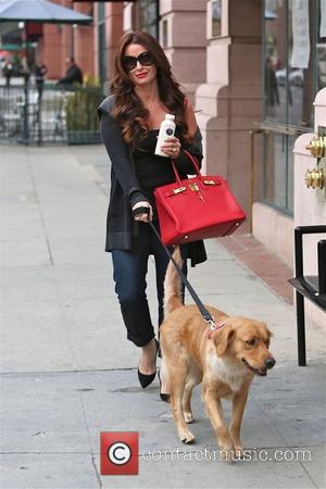Kyle Richards and Bambi - Kyle Richards walks her dog Bambi in Beverly Hills - Los Angeles, California, United States...