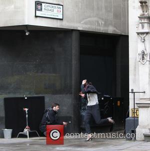 Milla Jovovich - Pierce Brosnan and Milla Jovovic film scenes for the new action movie Survivor in London - London,...