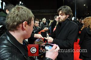 Tom Burke - The U.K. premiere of 'The Invisible Woman' held at the Odeon Kensington - Arrivals - London, United...