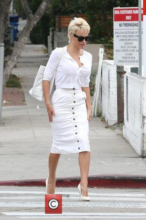 Pamela Anderson and Rick Salomon - Pamela Anderson and Rick Salomon have breakfast together at Urth Cafe in West Hollywood...