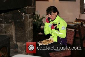 Davina McCall - Davina enjoys some refreshments by the fire, while talking on the phone, at the Stags Head in...