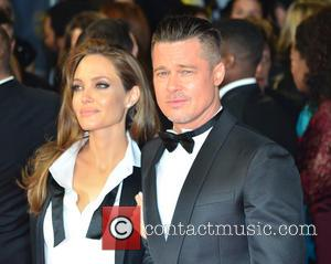 ANGELINA JOLIE and BRAD PITT - EE British Academy Film Awards (BAFTA) 2014 held at the Royal Opera House -...