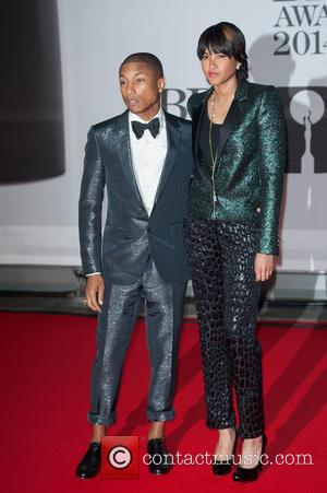 Pharrell Williams and Helen Lasichanh - The 2014 Master Card Brit Awards held at the O2 - Arrivals. - London,...