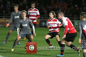 Louis Tomlinson - One Direction's Louis Tomlinson makes his Doncaster Rovers football debut at Keepmoat Stadium - Doncaster, United Kingdom...