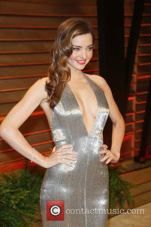 Miranda Kerr Gets Naked For GQ, Shares Love Of Sex, Sketching, And Taking It Slow