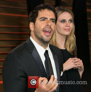 Eli Roth and Guest - 2014 Vanity Fair Oscar Party held at Sunset Tower in West Hollywood - Arrivals -...
