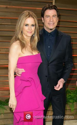Kelly Preston and John Travolta - Celebrities attend 2014 Vanity Fair Oscar Party at Sunset Plaza. - Los Angeles, California,...