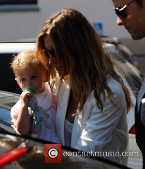 Gisele Bundchen Hosts Christening For Baby Daughter