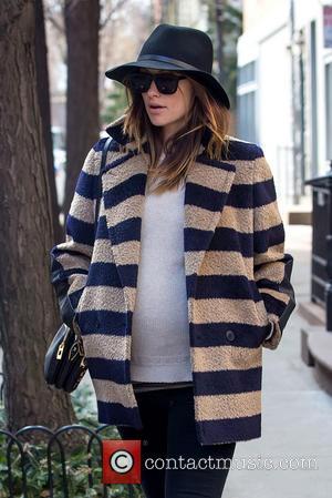 Olivia Wilde - Olivia Wilde takes a stroll alone on...