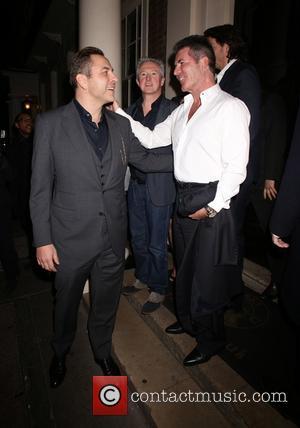 Louis Walsh, David Walliams and Simon Cowell - Simon Cowell and friends leaving The Arts Club - London, United Kingdom...