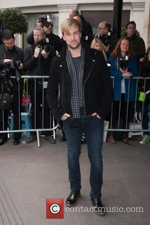 Kian Egan - The 2014 Tric Awards held at The Grosvenor House - Arrivals. - London, United Kingdom - Tuesday...