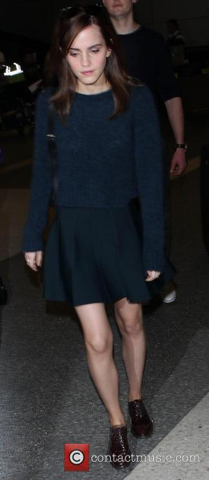 Emma Watson - Emma Watson arrives at Los Angeles International Airport (LAX) walking in brogues and matching skirt and wool...