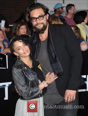 Lisa Bonet and Jason Momoa - Premiere of 'Divergent' held at the Regency Bruin Theatre - Arrivals - West Hollywood,...