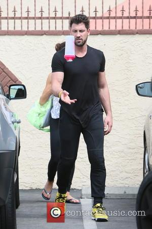 Maksim Chmerkovskiy - Meryl Davis seen at dance rehearsals for television show Dancing with the Stars, when Meryl leaves rehearsals...
