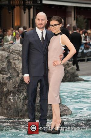 Darren Aronofsky and Guest - 'Noah' UK Premiere held at the Odeon Leicester Square - Arrivals. - London, United Kingdom...