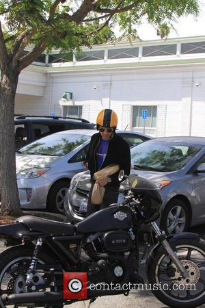 Olivier Martinez - Olivier Martinez pick up a French Baguette from Bristol Farms on his Classic Harley Davidson Motorcycle -...