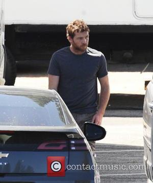 Sam Worthington - Sam Worthington gets a visit from girlfriend Lara Bingle on the set of