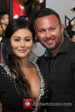 Jenni 'Jwoww' Farley and Roger Mathews - 23rd Annual MTV Movie Awards at the Nokia Theatre - Arrivals - Los...