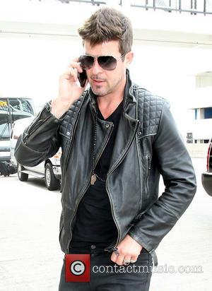 Robin Thicke Apologizes To Estranged Wife Paula Patton During Bet Awards Performance