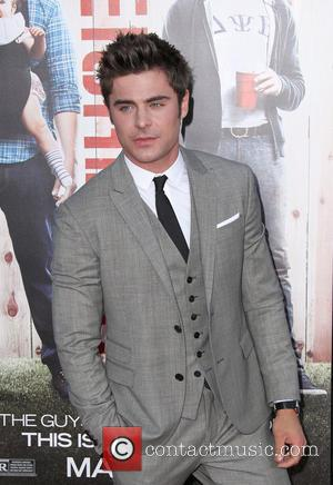 Zac Efron Reportedly In Talks To Star In 'Baywatch' Movie With Dwayne Johnson
