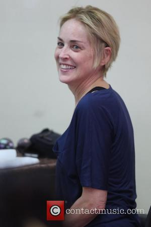 Sharon Stone - Sharon Stone visits the Beverly Hills Nail Design with her son Quinn Kelly Stone for a manicure...