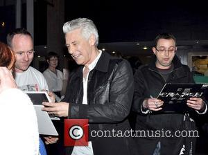 Adam Clayton - U2 bassist Adam Clayton and his wife Mariana Teixeira arrive at RTE studios for The Late Late...