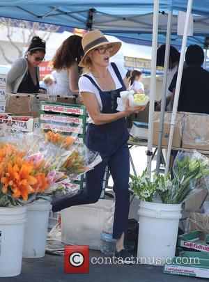 Julie Bowen - Julie Bowen, wearing cotton overalls, spotted grabbing food for her three sons at a farmers' market. Bowen...