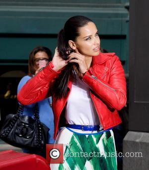 Adriana Lima Slams Head Into Bus Mirror