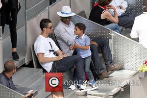 Cristiano Ronaldo, Cristiano Junior and Cristiano Jr - Real Madrid football player Cristiano Ronaldo with his son at the Mutua...