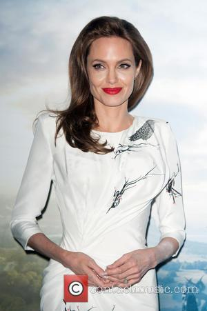 Angelina Jolie Attends Film Premiere With Her Estranged Father