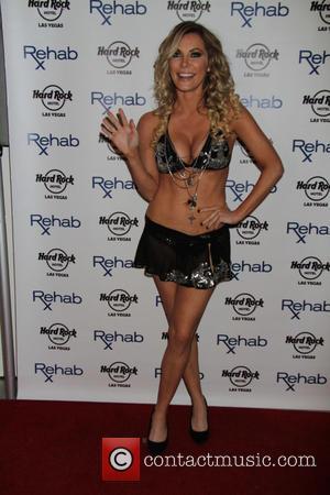 Crystal Hefner - Joanna Krupa, star of Bravo's 'Real Housewives of Miami,' and her sister Marta Krupa, host 'Rehab Bikini...