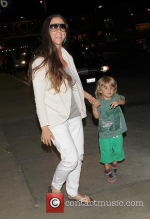 """Alanis Morissette, Mario """"Souleye"""" Treadway and Ever Imre Morissette-Treadway - Alanis Morissette and her husband  Mario"""