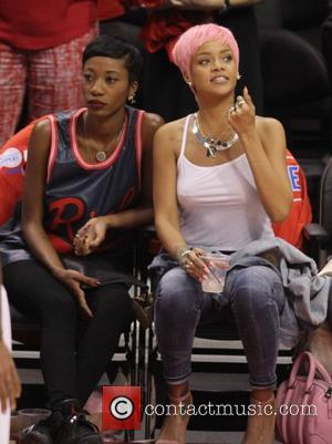 Rihanna Turns Heads With Bra-less Display At Basketball Game