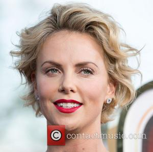 Charlize Theron And Sean Penn Go Public At 'A Million Ways To Die In The West' Premiere [Pictures]