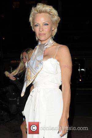 Pamela Anderson - Pamela Anderson arriving at the Gold Beach Party - Cannes, France - Friday 16th May 2014