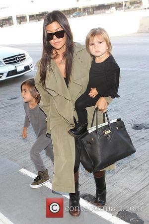 Kourtney Kardashian, Penelope Disick and Jason Mason Disick - Kourtney Kardashian has her hands full carrying daughter Penelope Disick and...