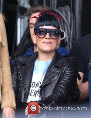 Lily Allen - Lily Allen and Nick Grimshaw watch One Direction's performance on the Main Stage of the Radio 1...