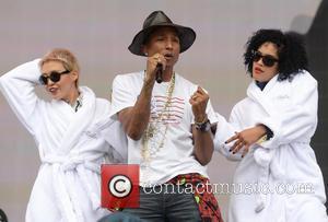 Pharrell Williams Hugs Harlem's Tree Of Life Before Apollo Theater Gig