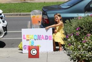 Anja Mazur - Alessandra Ambrosio watches her daughter Anja sell home made lemonade on a street in Brentwood - Los...