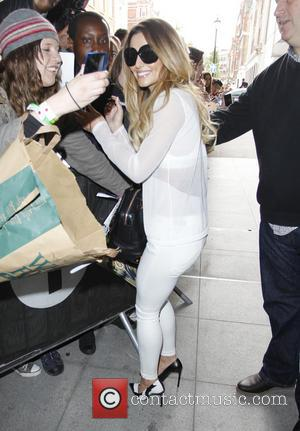 Cheryl Cole - Cheryl Cole leaves the BBC Radio 1 studios and poses for pictures with waiting fans - London,...