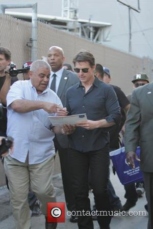 Tom Cruise and Yehia Mohamed - Tom Cruise waves to fans and signs autographs as he leaves the Jimmy Kimmel...
