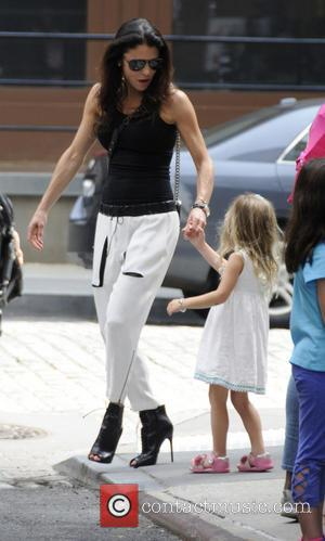 Bethenny Frankel and Bryn Hoppy - Bethenny Frankel dressed in a black top with white bottoms, goes on the school...