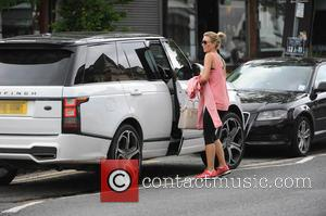 Alex Gerrard - Alex Gerrard returns to her car after leaving the gym. The popular WAG had parked her Range...