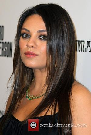 "Mila Kunis Talks Bump, Bell-Bottoms, Black Swan, And Reveals Ashton Is Her ""Movie Star Crush"""