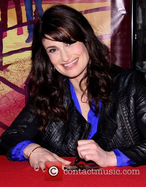 Idina Menzel Flashes Breast During Concert