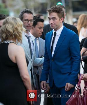 Guy Pearce and Robert Pattinson