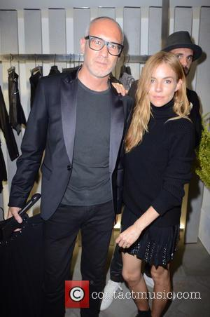 Sienna Miller and And Guest